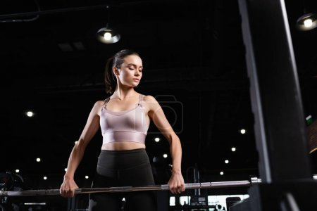 athletic woman in sports bra training with power rack in sports center