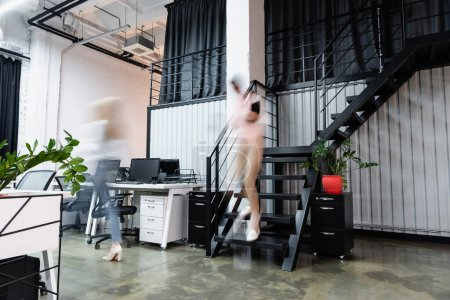 Photo for Motion blur of businesswomen walking in modern office - Royalty Free Image