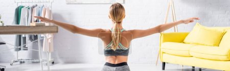 Photo for Back view of sportswoman training at home, banner - Royalty Free Image