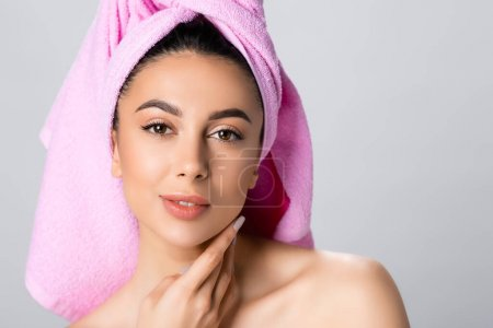 Photo for Beautiful woman with towel on hair isolated on grey - Royalty Free Image
