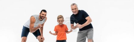 kid with father and granddad in sportswear smiling at camera while demonstrating strengths isolated on white, banner