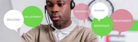 african american interpreter in headset near illustration of speech bubbles with word welcome in different languages, banner