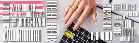partial view of interpreter pressing translation key on laptop, welcome word in different languages illustration, banner