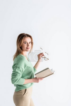 Photo for Cheerful woman holding glasses and book isolated on white - Royalty Free Image