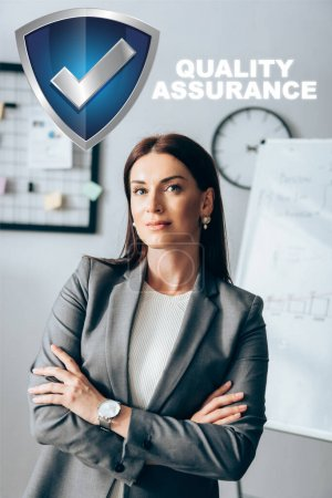 Investor standing with crossed arms in office near shield and quality assurance illustration