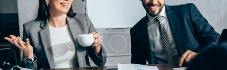 Cropped view of smiling businesspeople with coffee in office, banner