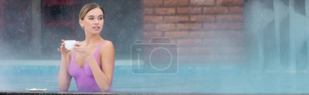 Photo for Young woman in swimsuit holding cup of coffee in outdoor swimming pool, banner - Royalty Free Image