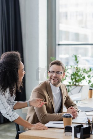 Positive interracial business people working together in office