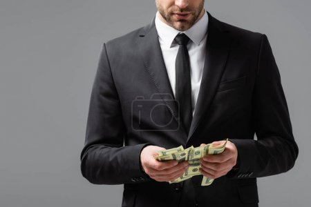partial view of businessman counting money isolated on grey