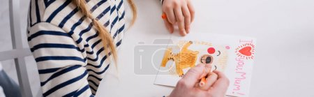 Photo for Partial view of father and daughter drawing mothers day card with i love you mum lettering, banner - Royalty Free Image