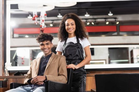 Photo for African american hairdresser and client smiling at camera in salon - Royalty Free Image