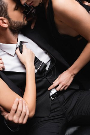 high angle view of passionate women undressing young businessman in suit