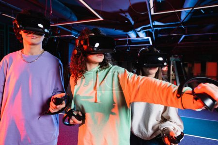 Photo for Interracial teenage friends in vr headsets gaming in play zone - Royalty Free Image