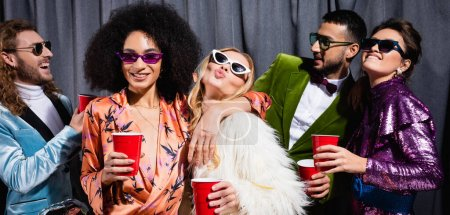 Photo for Playful interracial friends in sunglasses on grey background, banner - Royalty Free Image