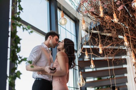 Photo for Couple with closed eyes standing close in restaurant - Royalty Free Image