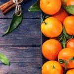 Постер, плакат: Tangerines with cinnamon