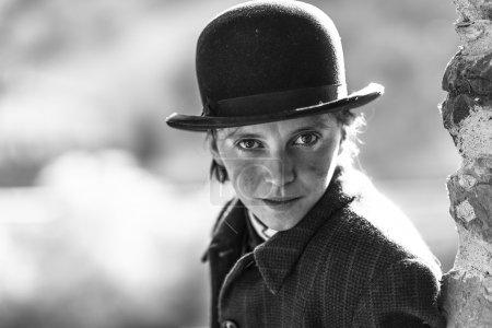Woman dressed as Charlie Chaplin man style