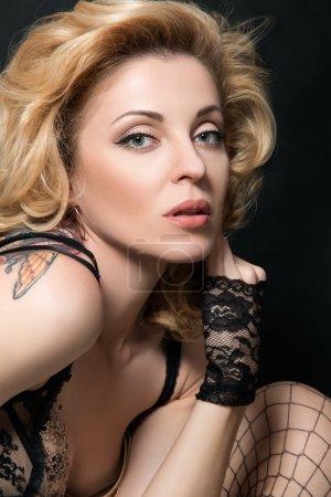 Portrait of mature sensual woman in sexy linen