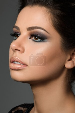 Close-up portrait of young beautiful tanned woman