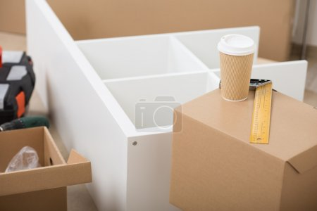 Photo for Unpacking and putting together self assembly furniture after relocation. DIY, new home and moving concept. - Royalty Free Image