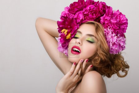 Close-up beauty portrait of young pretty girl with flowers in he