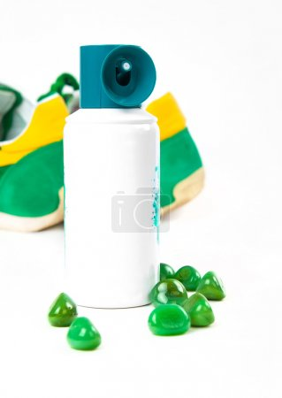 Bottle spray of sports men perfume, sneakers, sunglasses on whit