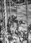 Black And White Image Of Old Steam Carousel Horses