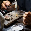 Working Hands master goldsmith at the company in T...