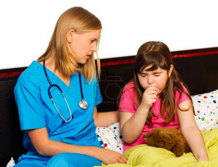 Photo for Doctor examining her little patient with severe coughing. - Royalty Free Image