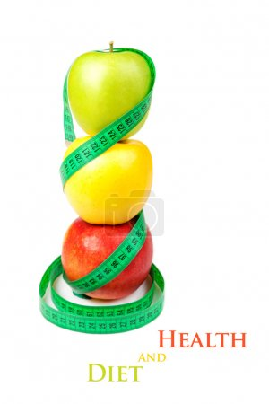 Three apples with measuring tape on a white background