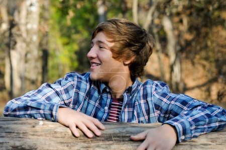 Handsome teen boy with long hair.