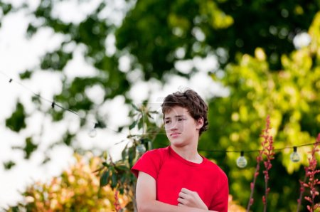 teenage boy outside looking sideways