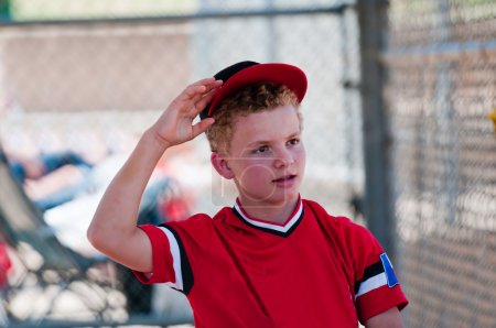 baseball player taking hat off