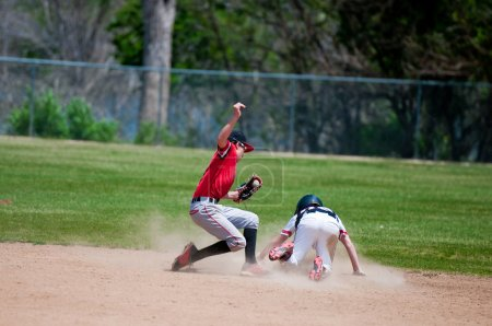 baseball shortstop tagging player out