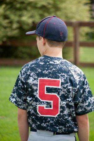 Youth baseball boy from behind