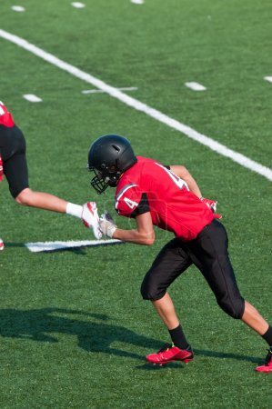 Photo for American football boy during a game on the field. - Royalty Free Image
