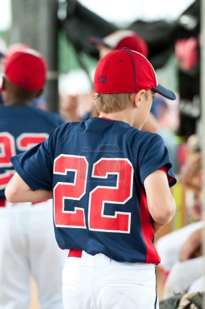 Young baseball player in the dugout