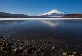 Mountain Fuji and Achi lake in winter season