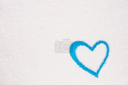 Heart shape painted on frozen window