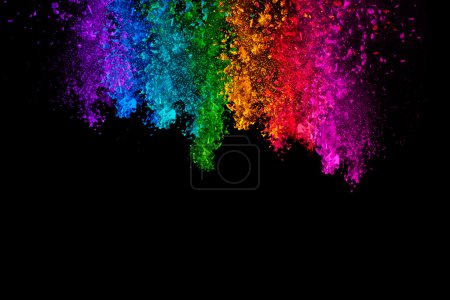 Falling colored powder isolated on black background