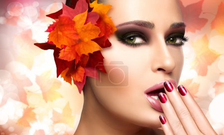 Photo for Autumn makeup and nail art trend. Fall beauty fashion girl. Professional makeup and manicure. Closeup portrait on autumnal background with falling leaves - Royalty Free Image