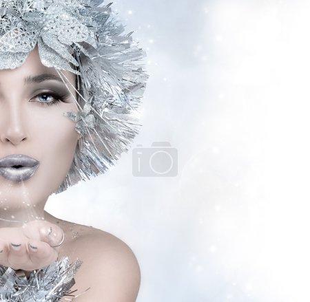 Beauty Christmas Girl Sending a Kiss
