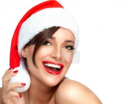 Happy Christmas Girl in Santa Hat. Beautiful Big Smile
