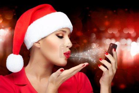 Christmas Woman in Santa Hat Taking a Selfie Sending Kisses