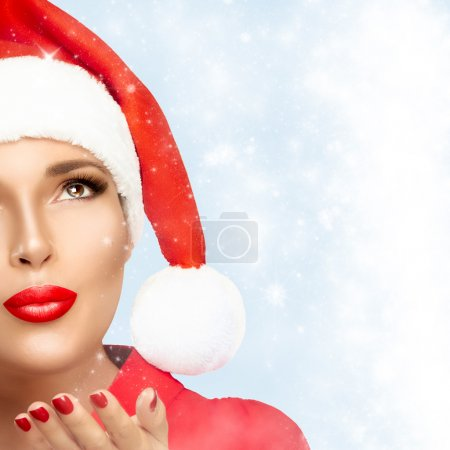 Beauty Fashion Christmas Woman in Santa Hat Looking Stardust Fal