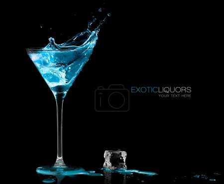 Photo for Stemmed cocktail glass with blue alcoholic drink splashing out, close-up isolated on black. Template design with sample text - Royalty Free Image