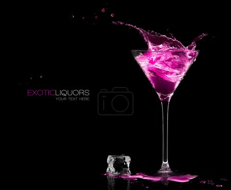 Photo for Stemmed cocktail glass with strawberry liquor splashing out, close-up isolated on black. Template design with sample text - Royalty Free Image