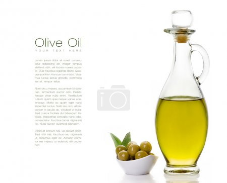 Olive Oil on Bottle with Olive Seeds on the Side