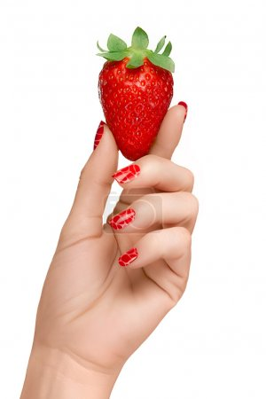 Woman with Red Manicured Nails Holding a Strawberry