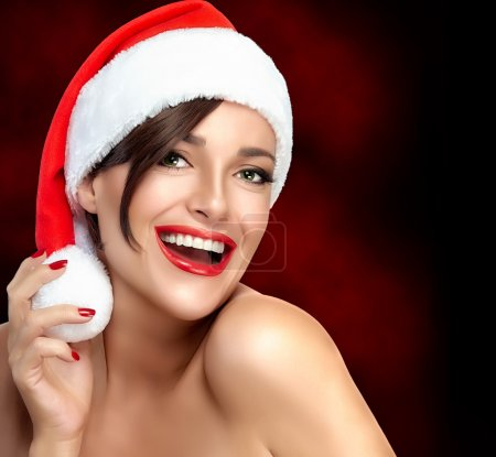 Vivacious Sexy Girl in a Santa Hat.  Beautiful Big Smile